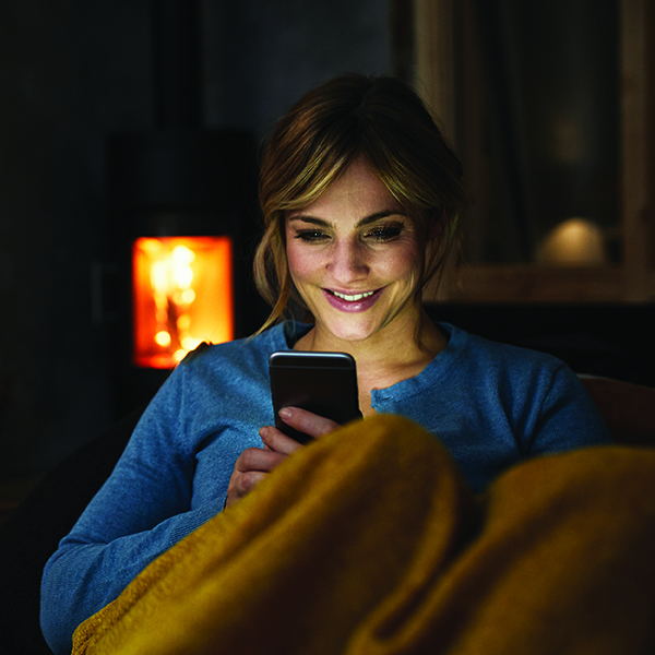 Woman using a phone in living-room